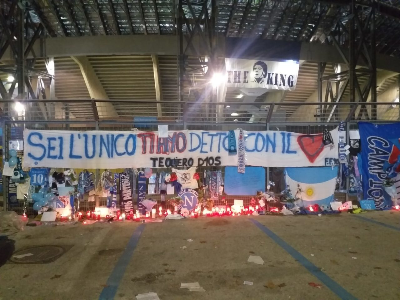 Napoli fans pay tribute to Diego Armando Maradona outside the stadio San Paolo the day after his death