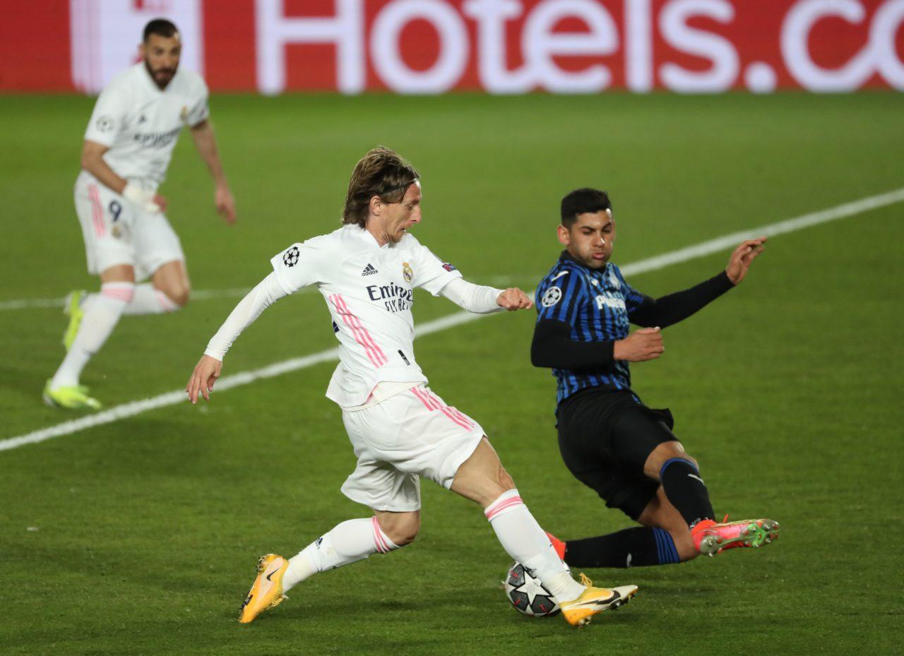 Atalanta defender Cristian Romero tackles Real Madrid's Luka Modric