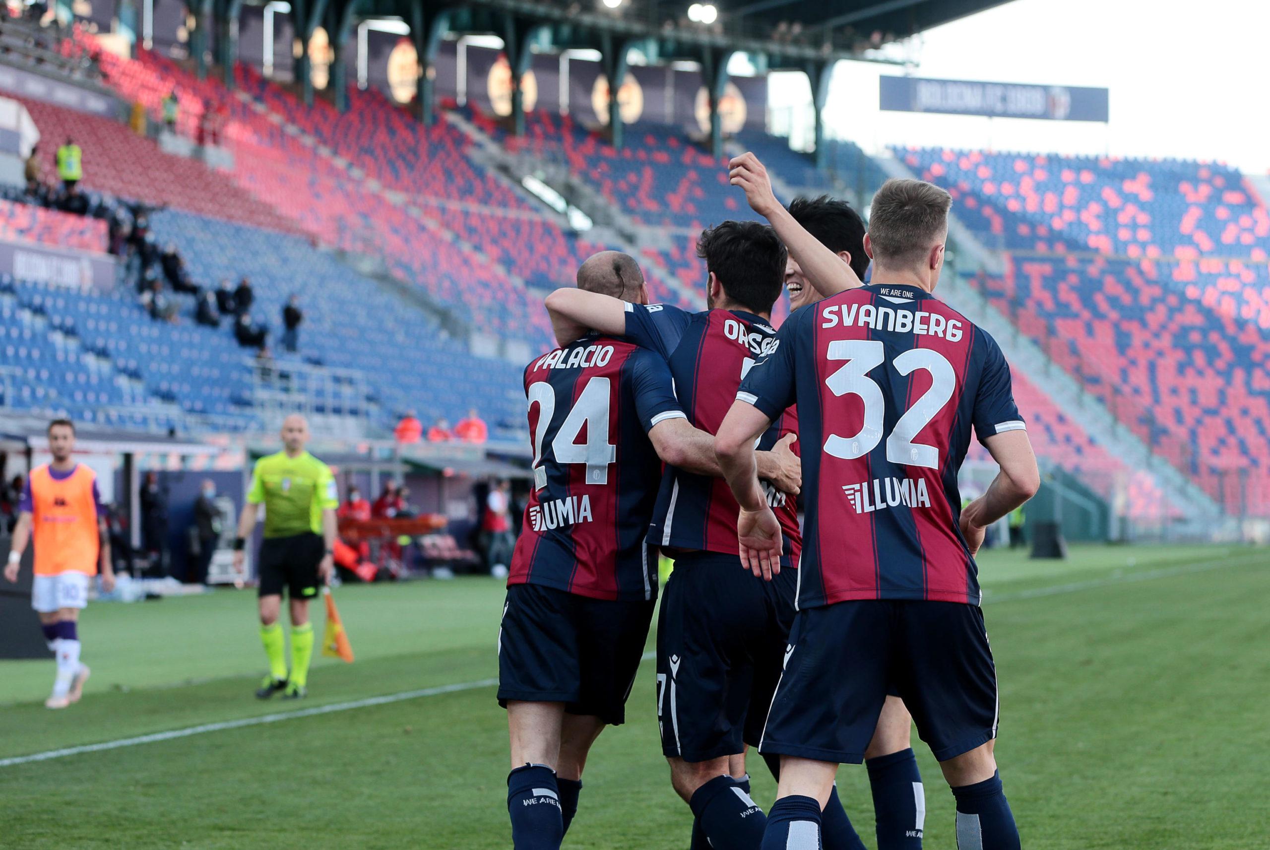 Bologna players celebrate a goal