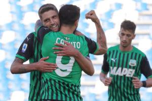 Domenico Berardi and Francesco Caputo embrace
