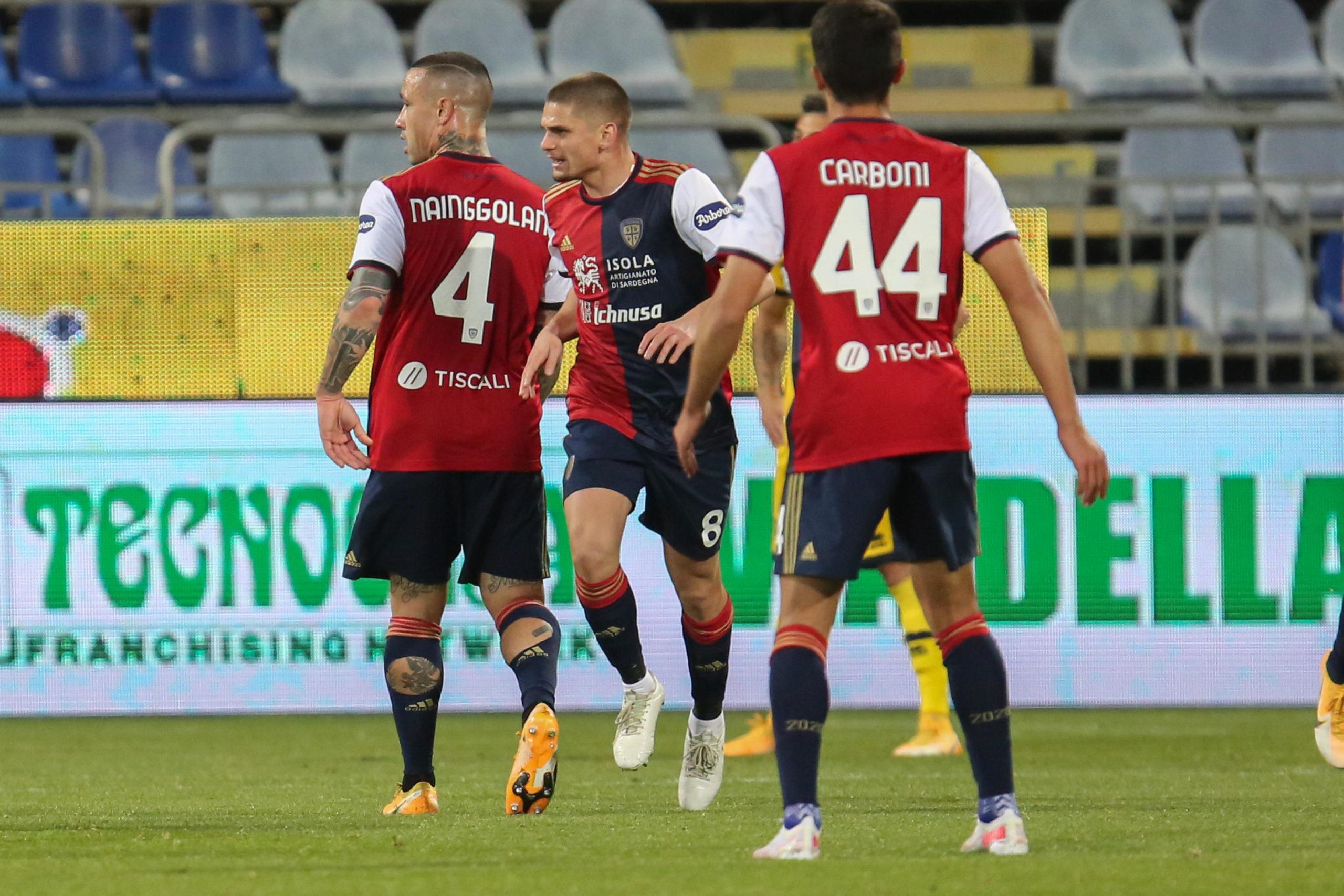 Razvan Marin celebrates a goal for Cagliari against Parma
