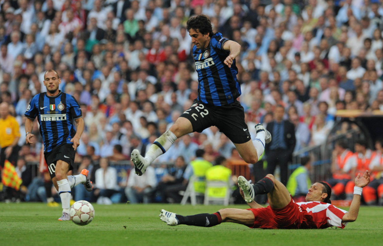 Diego Milito rides a challenge from Martin Demichelis in the 2010 Champions League Final