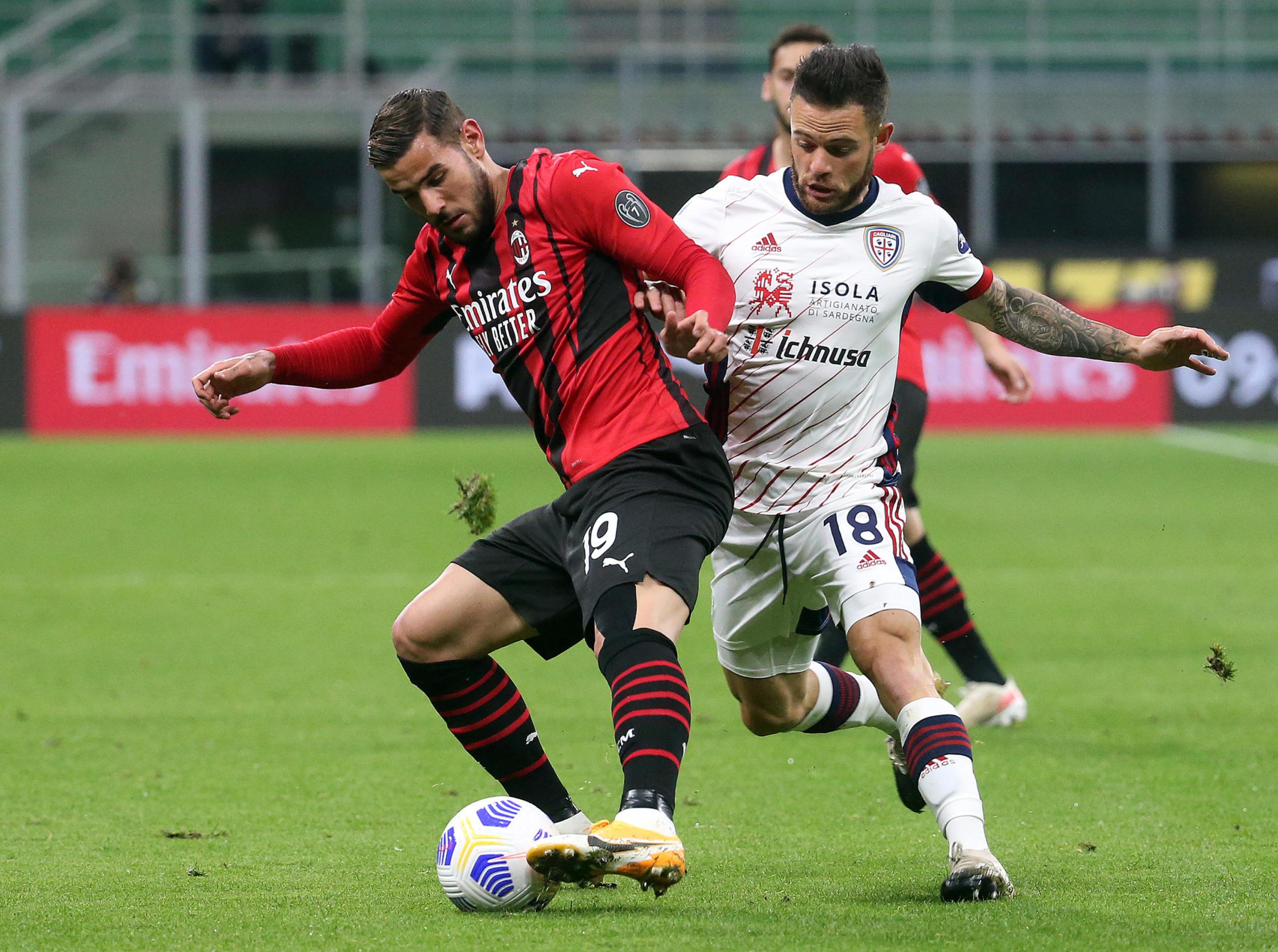 Cagliari's Nahitan Nandez holds off Milan's Theo Hernandez