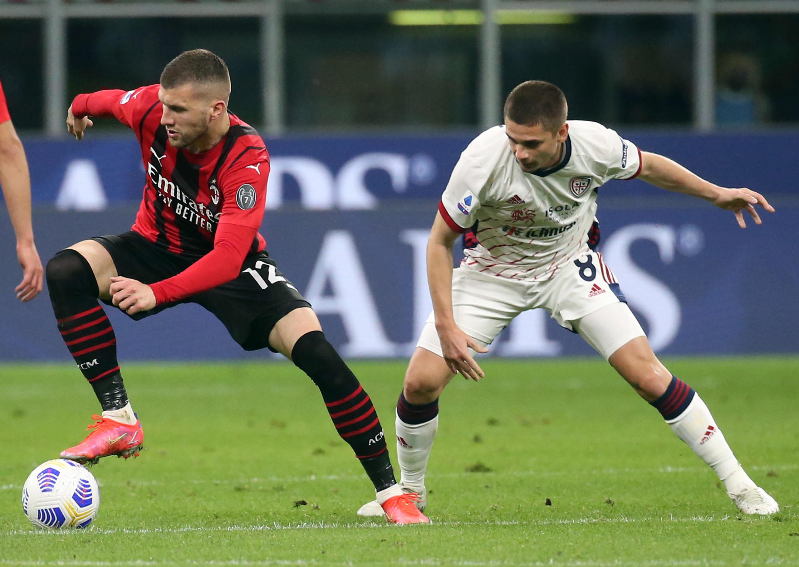 Cagliari's Razvan Marin challenges Milan's Ante Rebic