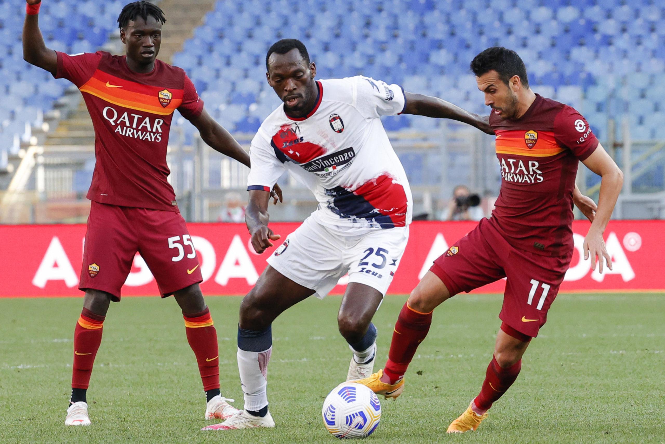 Crotone's Simy pressured by Roma pair Pedro Rodriguez and Ebrima Darboe