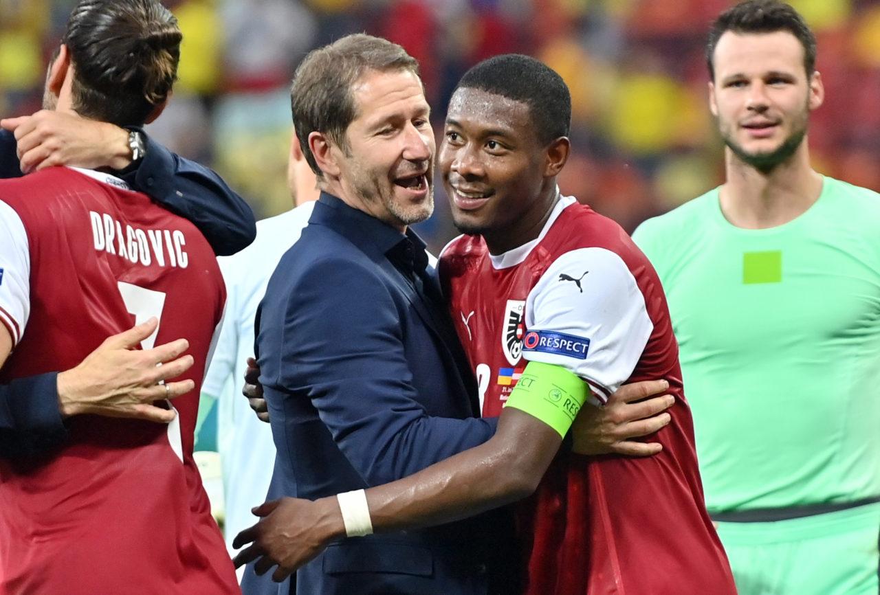 David Alaba hugs coach Franco Foda after Austria's 1-0 win over Ukraine at Euro 2020.