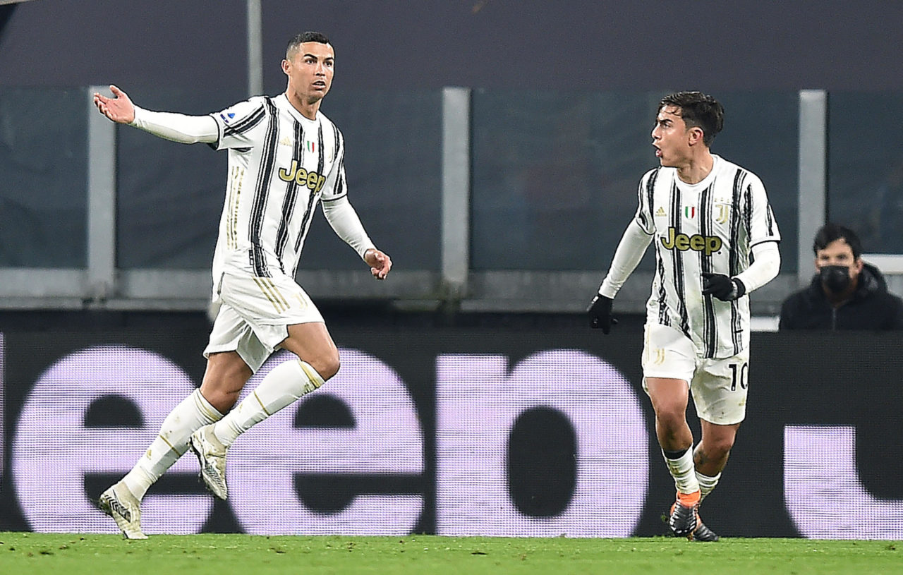 epa08917621 Juventus? Cristiano Ronaldo (L) celebrates with his teammate Paulo Dybala after scoring the the 1-0 goal during the Italian Serie A soccer match Juventus FC vs Udinese Calcio at the Allianz Stadium in Turin, Italy, 03 January 2021. EPA-EFE/ALESSANDRO DI MARCO