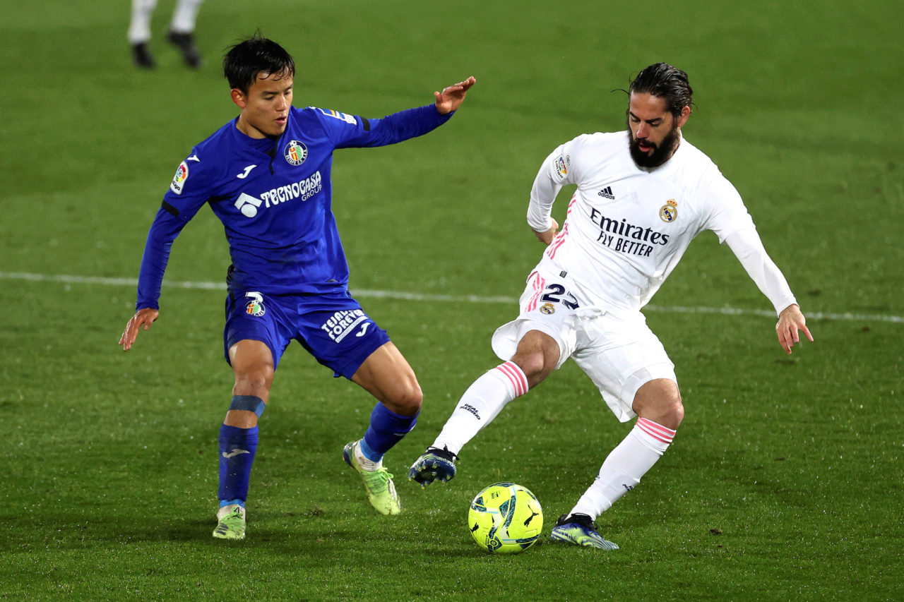 Real Madrid's Isco (R) in action against Getafe's Takefusa Kubo (L) during the Spanish La Liga match between Real Madrid and Getafe.