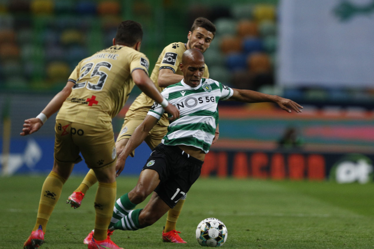 Sporting's player Joao Mario (R) in action against Y. Hamache of Boavista FC during the Portuguese First League soccer match held at Alvalade Stadium in Lisbon