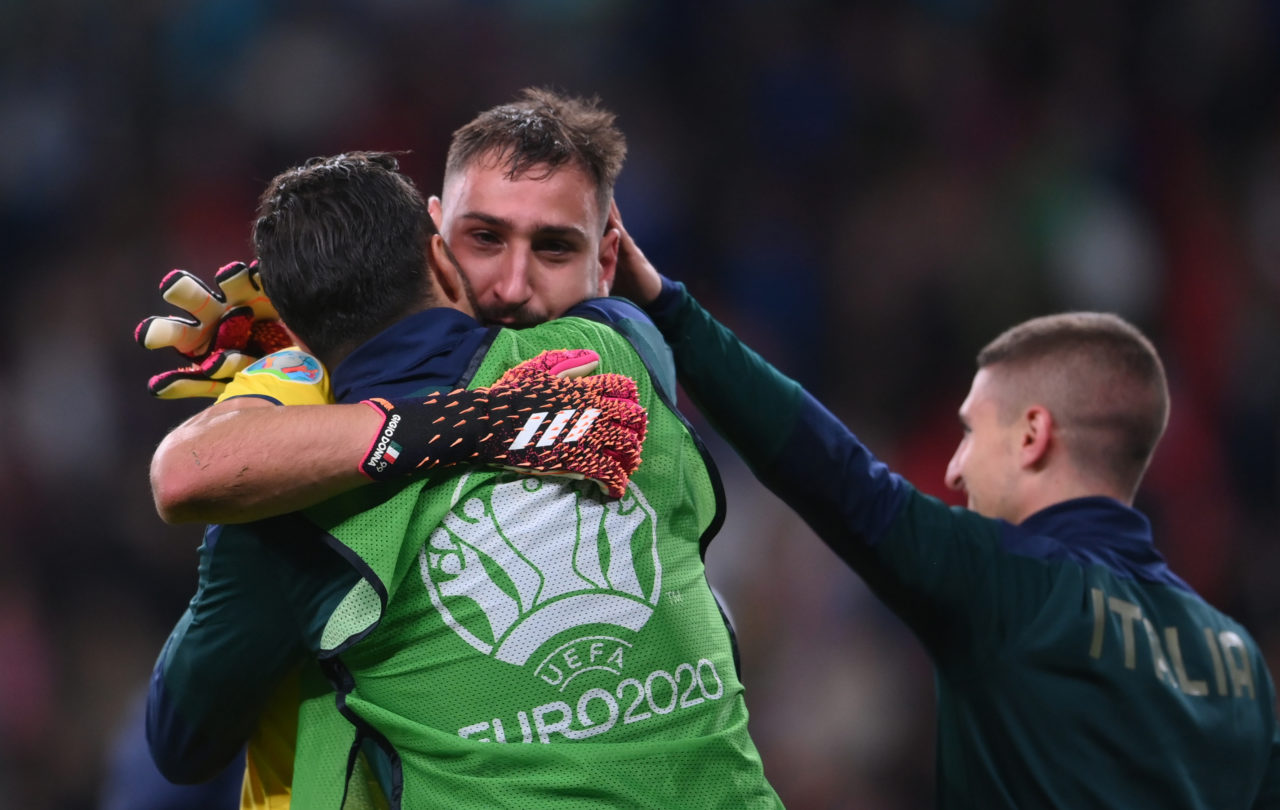 Gianluigi Donnarumma (C) of Italy celebrates winning the penalty shoot-out of the UEFA EURO 2020 semi final between Italy and Spain in London