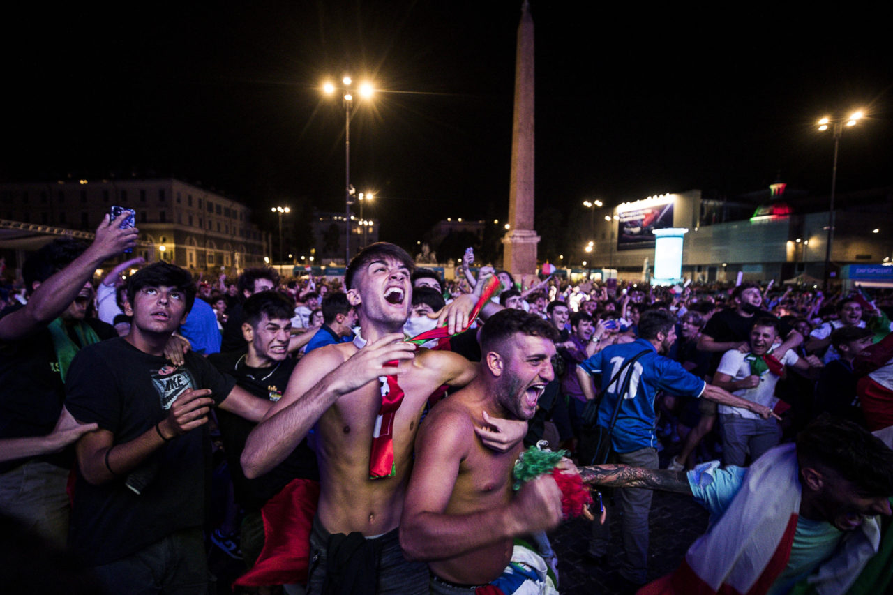 Italy fans cheer on their team as they watch the UEFA EURO 2020 semi final match between Italy and Spain at a public viewing in Piazza del Popolo, Rome