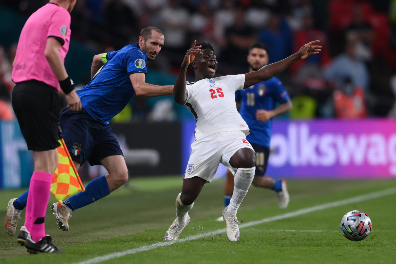 Giorgio Chiellini of Italy (L) fouls Bukayo Saka of England during the UEFA EURO 2020 final between Italy and England in London, Britain, 11 July 2021.