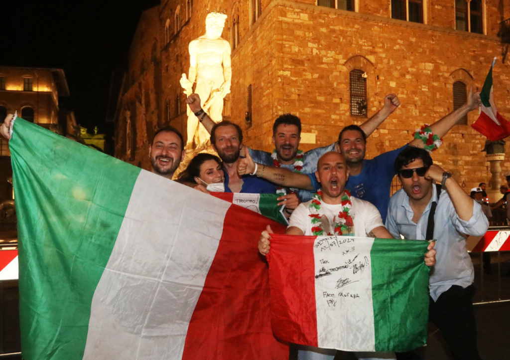 Italy's supporters celebrate their team's victory in the UEFA EURO 2020 Championship at the end of the final against England, played at the Wembley stadium in London; in Florence, Italy