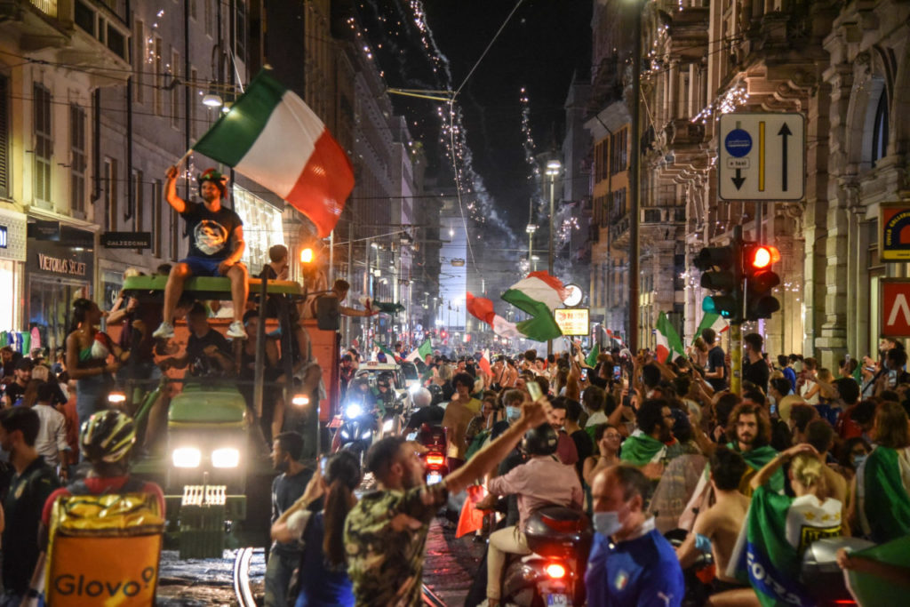 Italy's supporters celebrate their team's victory in the UEFA EURO 2020 Championship at the end of the final against England, played at the Wembley stadium in London; in Milan, Italy, 11 July 2021.