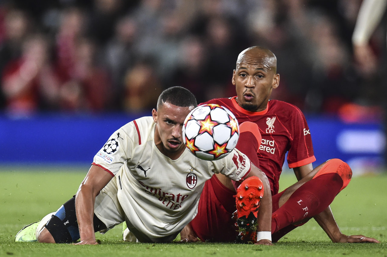 epa09470467 Ismael Bennacer (L) of AC Milan and Fabinho (R) of Liverpool FC in action during the UEFA Champions League group B soccer match between Liverpool FC and AC Milan in Liverpool, Britain, 15 September 2021. EPA-EFE/Peter Powell