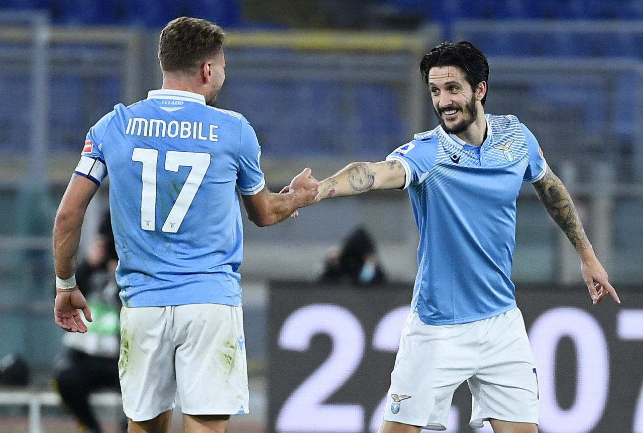 epa08940502 SS Lazio's Luis Alberto (R) celebrates with his teammate Ciro Immobile after scoring the 3-0 goal during the Italian Serie A soccer match between SS Lazio and AS Roma in Rome, Italy, 15 January 2021. EPA-EFE/ETTORE FERRARI