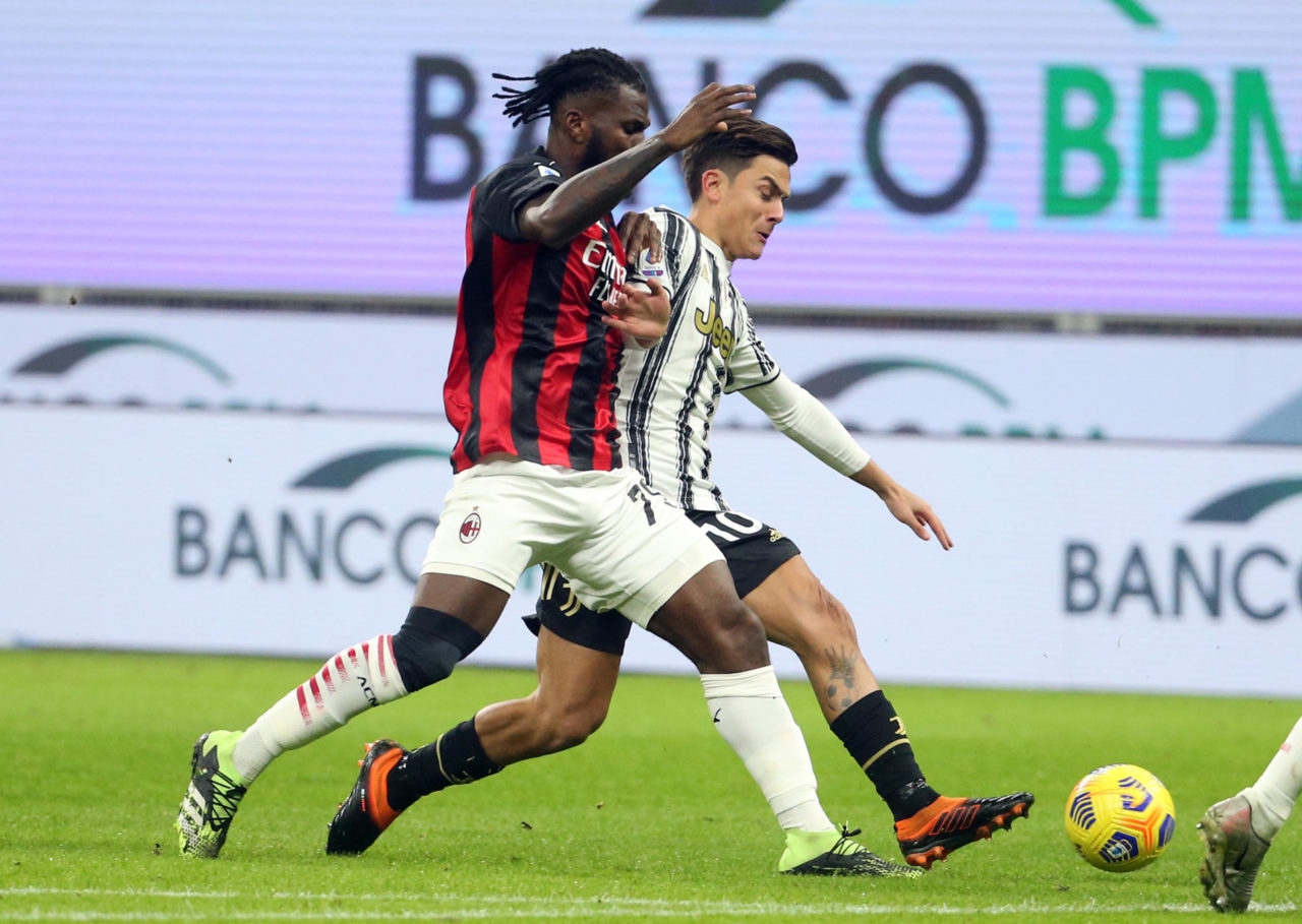 epa08923352 Milan's Franck Kessie (L) challenges for the ball Juventus' Paulo Dybala during the Italian serie A soccer match between Ac Milan and Juventus FC at Giuseppe Meazza stadium in Milan, Italy, 06 January 2021. EPA-EFE/MATTEO BAZZI