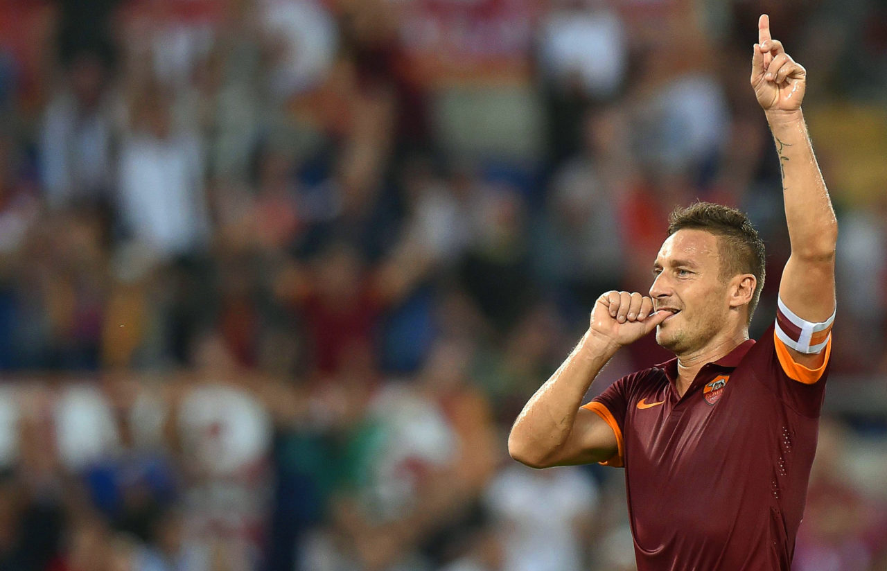 epa05942185 (FILE) Roma's Francesco Totti celebrates after scoring the 3-0 lead from the penalty spot during the Italian Serie A soccer match between AS Roma and AC Chievo Verona at the Olimpico stadium in Rome, Italy, 18 October 2014 (reissued 03 May 2017). Italian Serie A side AS Roma confirmed on 03 May 2017 that Roma legend Francesco Totti will retire at the end of the season. The 40-year-old scored 250 goals in 616 appearances for the Giallorossi since 1993 and won the FIFA World Cup in 2006. EPA/ETTORE FERRARI
